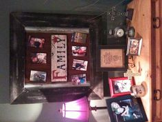 My hubby made this frame for me using old barn tin and fence board, then he put a sign my Mom bought for me in the middle. Then I just put magnets on the back of the pictures and arranged them. It goes well with my rustic home <3