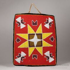 """L.14 ¼"""" : W. 11 ⅞"""" Dynamic geometric beaded bag with an eight pointed star on a…"""