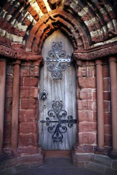 Love the Iron work on these doors!!