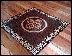 Marble inlays set in wood flooring