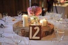 Wood chunk centrepiece with candles and dahlias  Image by Nordica Photography