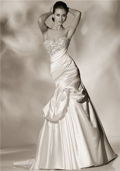 Strapless fit; flare gown with heavily encrusted bodice.  Asymetrical pleating along waistline and sodt draping on skirt adds drama sophistication - Cristiano Lucci