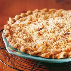 Cheesy Apple Pie There's rich cheddar cheese in both the pastry and topping of this tangy, out-of-the-ordinary apple pie recipe.