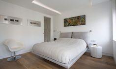 Hardwood bedroom floor with a grey bed - Home Decorating Trends - Homedit