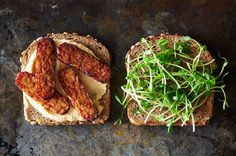 Vegan sandwiches don't get any better than this. Hearty tempeh, which has been given a salty and smoky marinade, meets creamy hummus. Garnish with something green and crisp--like pea shoots, shredded romaine, or a sprinkle of green pepper, for contrast.