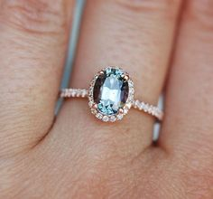 Green sapphire Rose gold engagement ring. Engagement ring by Eidelprecious. This ring features a 1.39ct cushion sapphire. The color is gorgeous