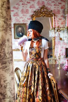 Fashion. Portrait. Wallpaper. Red Hair. Snake print. Chandelier. Pink. Creative. Beautiful. Photo by Pia Inberg.