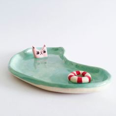 Another kitty plate you can see his angry pink face reflected in the glaze he will be available to purchase tomorrow by laurie_melia