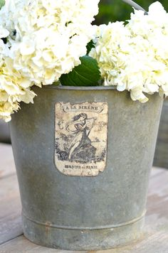 Vintage French Zinc bucket with Beautiful Old Label. $95.00, via Etsy.
