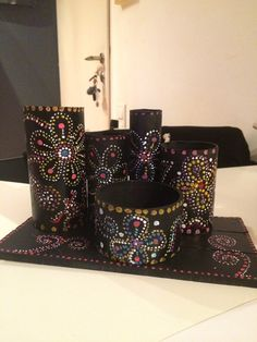 stationary holder- i made it with toilet rolls,kitchen towel roll, old sticky tape roll and so on, painted them all black and a surface from wood i found, then decorated it with acrylic paints, and glued it on the wood with hot glue gun.