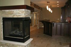 Beautiful basement remodel with fireplace insert and custom stone work