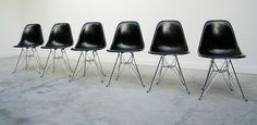 6 black Charles Eames DSR fibreglass shell dinning chairs. Modern online gallery. Featuring a varied selection of vintage furniture and architect furniture. At http://www.furniture-love.com/vintage/furniture/
