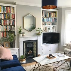 Focal Point I lusted after this west elm UK mirror for mon… - Home Professional Decoration Bookshelves In Living Room, Living Room Mirrors, Living Room With Fireplace, New Living Room, Interior Design Living Room, Living Room Designs, Living Room Decor, 1930s House Interior Living Rooms, Alcove Bookshelves