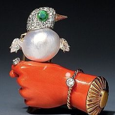 How ridiculously adorable is this 1930s brooch from #Cartier? Coral diamonds and stunning examples of emerald & pearl. I would wear this every day!  #gemstones #designer #designerjewelry