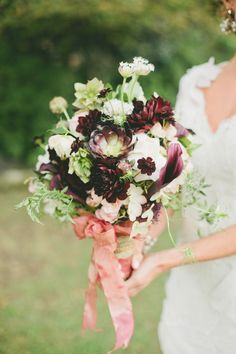 Stunning Bouquet with dark rich burgundy + softer shades = romantic! See more on SMP: http://www.StyleMePretty.com/2014/01/30/figs-gold-wedding-inspiration OneLove Photography | Seed Floral Couture