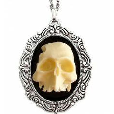 Hand-made with meticulous care, the Half Skull Cameo Necklace features amazing detail of a 3D deteriorated skull on a black resin background.