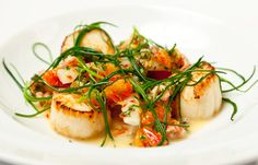 Seared scallops with salsify, blood orange and brown shrimp
