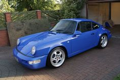 Porsche 964  Not sure why you wouldn't put Fuchs on it, but the color is amazing!