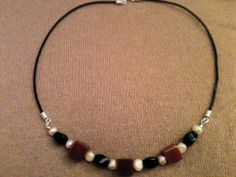 Pearl, carnelian, onyx and leather cord necklace with a sterling lobster claw clasp. on Etsy, $30.00