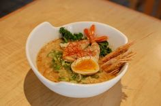 Kaisen Ramen on board... A hearty Tonkotsu based broth with a hint of seafood topped with - Red Shrimp (Aka Ebi,) deep fried Shrimp head, Ankimo (Monkfish Liver Pate), Kale, Green Onion, Soft Boiled Egg, and Sesame Seeds.
