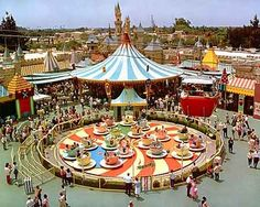 "Mad Tea Party. This opening day attraction, based on a scene in ""Alice in Wonderland,"" spins Disneyland guests in giant teacups. Pictured here at its original location, it was moved near the Matterhorn in 1983 during the construction of the new Fantasyland."