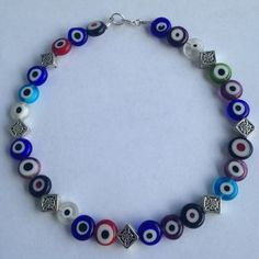 Evil Eye Anklet Protect yourself with this evil eye anklet with diamond cut spacers with sterling silver clasp. Handmade. New! Cindylou's Design Jewelry