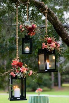 Adorable way to add some outdoor lighting to your party to set the mood. Hang outdoor lanterns on a tree and decorate them with flowers or whatever else fits the theme.