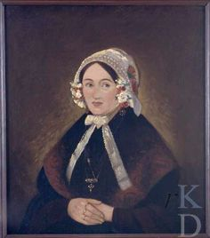 Jan Haak Portret van Francisca de Rechter (1832- ); gehuwd in Sint Jansteen 1852 Witte muts versierd met bloemen, strik onder de kin. Zwarte japon, kashmir omslagdoek. Gouden ketting met een kruishanger, handen voor het lichaam ineen, ringen aan de vingers. #Zeeland #Hulst