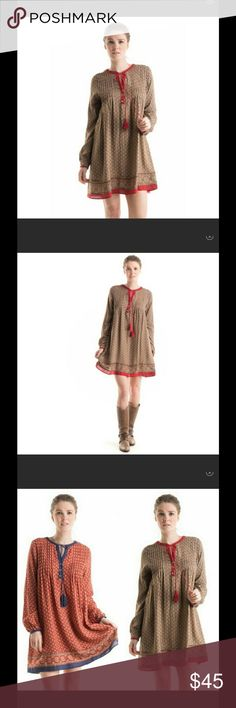 ‼️Price drop ‼️Long sleeve Tie front dress Long sleeve Tie front dress with back lace detail. There are two options : dress is a rust color with a red lace insert in the back and red tie in the front or dress is red with blue lace insert and blue front tie. 100% Rayon. Various sizes- small, medium and large. Fashionomics Dresses Long Sleeve