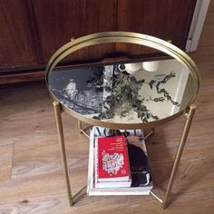 This DIYer had a mirror cut to fit atop a GLADOM tray table that she spray painted an antique brass color.