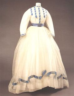 muslin wedding dress adorned with bright blue silk ribbon, worn by Alice Mary when she married Charles Robertson, founder of the Royal Watercolour Society in 1860s. Killerton, NT. Shelley Tobin, Marriage a la Mode