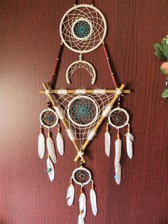 Large dream catcher, natural colors combined with turquoise wood beads natural yarn natural white feathers Perfect for home decor. approx size: 45x75 cm (15x27 inch) It brings love, light and positive energy and allows only your good dreams to slip down the feathers to bless you