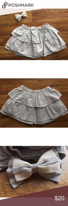Gymboree Pinstripe Skirt and Matching Bow Skirt is NWT. Top pinstripe layer: 100% cotton. Second tulle layer: 100% polyester. Third white layer: 100% cotton. Bow has been used once / twice.  •Bundle to make the most of shipping   •Cross posted Gymboree Bottoms Skirts
