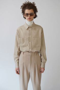 Acne Studios Denver Melton stone beige is a boxy fit casual shirt with a regular collar.