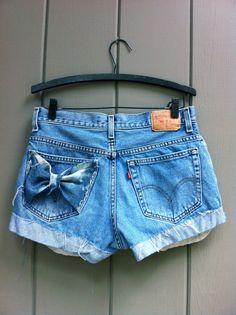 Levis High Waisted Cut Off Denim Shorts - Light Denim Pockets Showing Bleach Splashed Bow Pocket SIZE LARGE $32