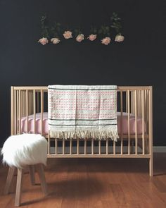Wow, a black nursery? The softer furniture items give it a lighter feel.