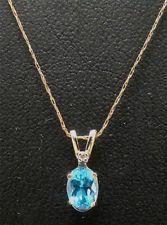 18k white gold bezel set blue topaz kings 16 y necklace 38g 10k yellow gold 12 ct oval blue topaz w diamond accent pendant 20 aloadofball Image collections