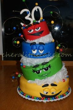 I wanted to make a special cake for my sister's 30th birthday.  She loves m&m's so this is what popped into mind.  The top three tiers are stroform and the bottem is s,more with marshmellow and ganche fill.