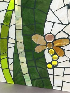 Part of a glass on glass door mosaic.