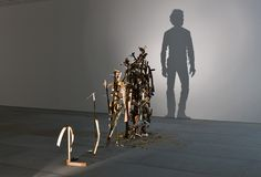 Tim Noble and Sue Webster Self-Imposed Misery (2010) Wooden stepladder, discarded wood, light projector.