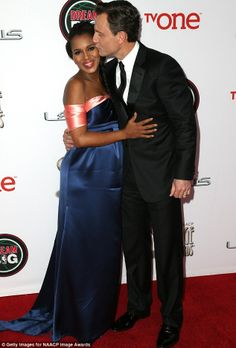 Kissing costars: Tony Goldwyn plants a big smooch on Kerry's cheek as the pair embrace on the red carpet