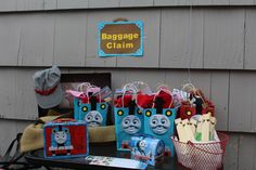 Favors Train whistles from dollar store. purchased gift bags and cut out Thomas design and glued on