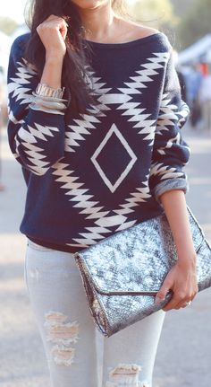 Tribal print jumper / sweater in navy and white with ripped jeans and oversize clutch