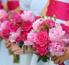 Gorgeous pink bouquets with light pink pink peonies, blush-colored roses and some spring green rose buds