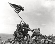 ICONIC PHOTO OF U.S. MARINES RAISING THE FLAG AT IWO JIMA    (AZ-089)    In one of the most iconic photos of the 20th Century, United States Marines r