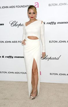 Nicole Richie gave us a vamped-up dose of vintage '40s flair in February, wearing a sexy white Halston dress with cutouts, paired with deep red lipstick and a slicked-back hairstyle.