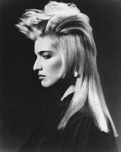 See this image on helenoppenheim.com: FROM SIDEBURN COLLECTION - 1985.  John Sahag, Workshop Launch.   Hair: John Sahag, John Sahag Workshop  ...  Makeup: Linda Mason ...  Model: Constance Chapman ... Photo: Bruno Juminer ...  Produced by Helen Oppenheim