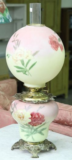"""lighting, America, An [unattributed] Gone with the Wind [parlor] lamp [having a] pierced base with milk glass pink to yellow shade and fontwith handpainted floral decoration. Burner is signed :Success"""" Circa Antique Hurricane Lamps, Hurricane Oil Lamps, Antique Oil Lamps, Vintage Lamps, Vintage Lighting, Globe Lamps, Globe Lights, Milk Glass Lamp, Victorian Lamps"""