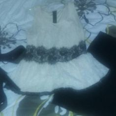 Black and ivory peplum top Cute top. In good condition, there is some minor staining under the arms Tops Blouses