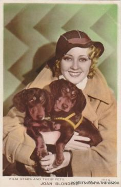 Joan Blondell and her two Dachshunds.